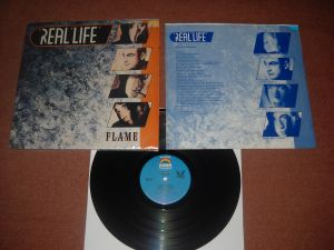 Real Life: Flame (1985) vinil new-wave/synth pop, Made In USA, stare VG+/Ex